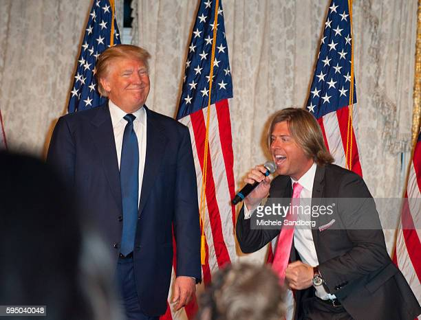 Beau Davidson singing to Donald Trump on stage Keynote Speaker Donald Trump with guest Dr Ben Carson attend the Palm Beach Lincoln Day Dinner at...