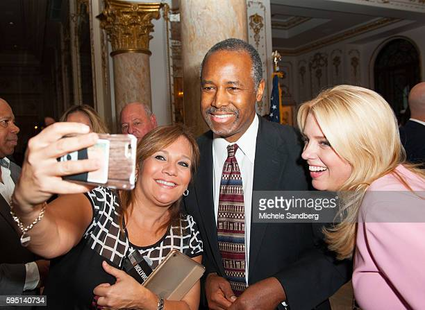 Bina Fink Dr Ben Carsoncenter FL Attorney General Pam Bondi on right taking a selfie Keynote Speaker Donald Trump with guest Dr Ben Carson attend the...