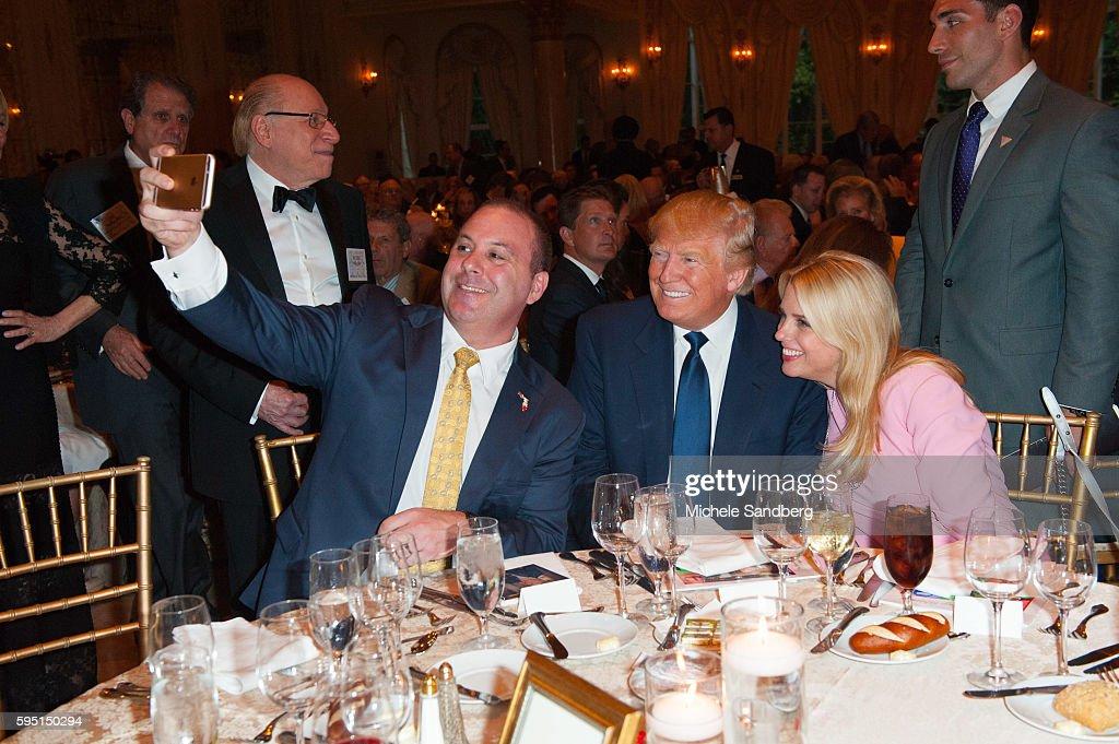 Blaise Ingoglia, Donald Trump, Pam Bondi taking a selfie. Keynote Speaker Donald Trump with guest Dr. Ben Carson attend the Palm Beach Lincoln Day Dinner at Mar-a-Lago, Palm Beach, Florida