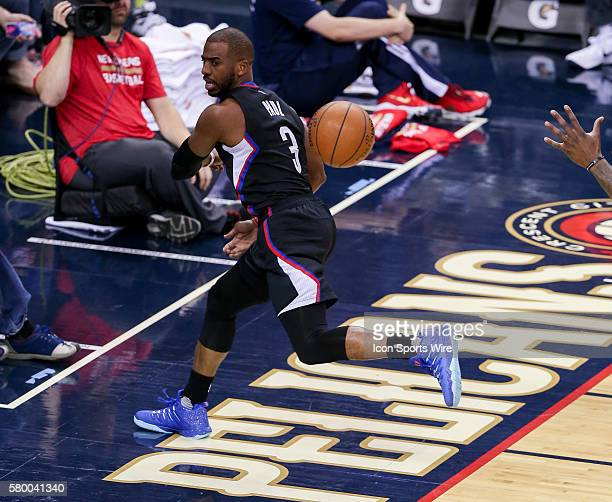 Los Angeles Clippers guard Chris Paul passes a ball as he heads off the court during the NBA game between the Los Angeles Clippers and the New...