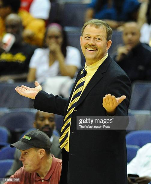 Good Counsel Head Coach Tom Splaine looks for a foul during action against HD Woodson on March 20 2012 in Washington DC