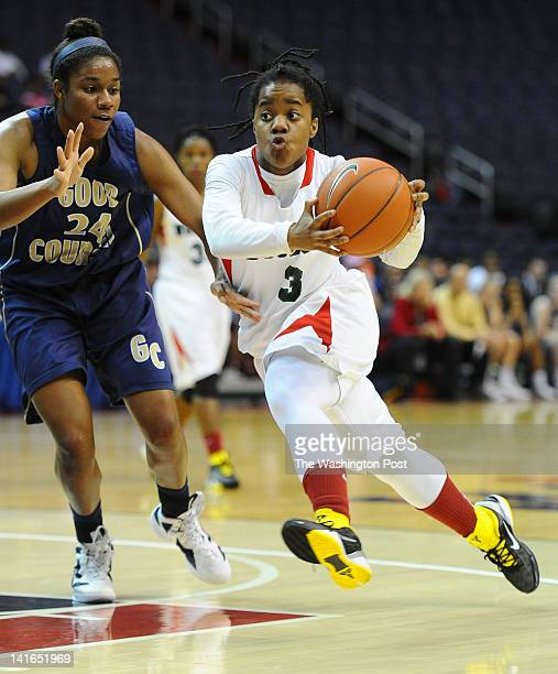 HD Woodson G Breonn Hughey drives to the basket against Good Counsel defender Sara Woods during 2nd half action on March 20 2012 in Washington DC