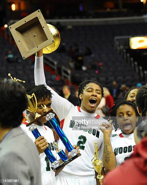 HD Woodson G Rahni Bell hoists the championship trophy after their win over Good Counsel on March 20 2012 in Washington DC