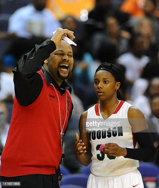HD Woodson head coach Frank Oliver Jr makes his point to G Chanel Green during action against Good Counsel on March 20 2012 in Washington DC
