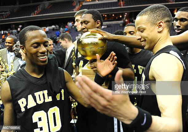 Paul VI G Stanford Robinson congratulates G Patrick Holloway as they receive the Abe Pollin City Title trophy after beating Coolidge on March 20 2012...