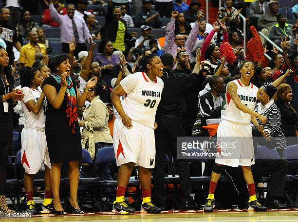 The HD Woodson bench and fan section start the celebration as they win over Good Counsel on March 20 2012 in Washington DC