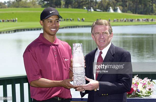 Tiger Woods receives the 2001 Players Championship trophy from PGA Tour commissioner Tim Finchem at TPC at Sawgrass in Ponte Vedra Beach, Florida....