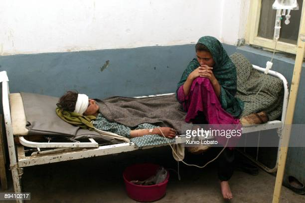29 March 2002 Baghlan Earthquake in old town Narhin in Baghlan Afganistan Victim attended by doctor
