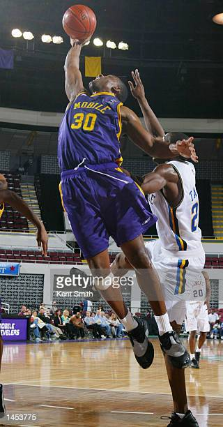 Derek Hood of the Mobile Revelers pulls down a rebound from Johnny Taylor of the Roanoke Dazzle at the Mobile Civic Center in Mobile Alabama DIGITAL...