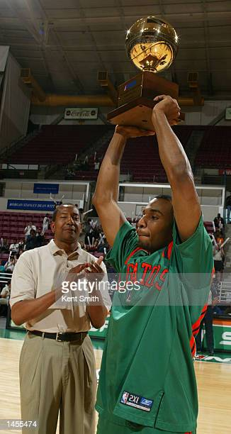 Fred House of the North Charleston Lowgators holds up his Trophy for NBDL Rookie of the Year before the game against the Mobile Revelers at the North...