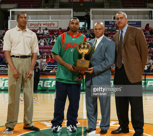 Fred House of the North Charleston Lowgators receives his trophy for NBDL Rookie of the Year with left to right coach Alex English Quenton Tin...