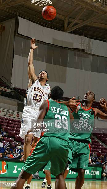 Rashad Phillips of the Mobile Revelers drives to the basket against Neil Edwards and Jamal Kendrick of the North Charleston Lowgators at the North...