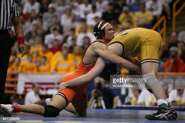 Chris Pendleton of Oklahoma State wrestles Ben Askren of Missouri during the 174 lb championship match at the Division 1 Wrestling Championships held...