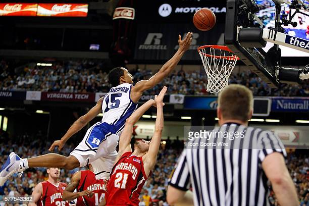 Duke guard/forward Gerald Henderson goes over Maryland guard Greivis Vasquez for the shot in the Duke Blue Devils 6761 victory over the Maryland...