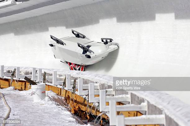 The Monaco 1 bobsled driven by Patrice Servelle with sidepushers Petr Narovec and Sebastien Gattuso and brakeman Alexandre Vanhoutte upside down in...