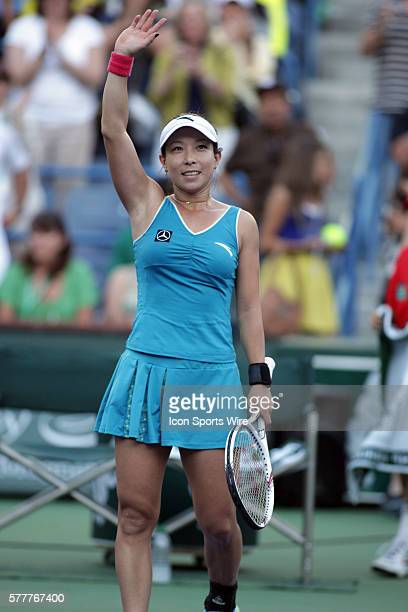 Jie Zheng of China celebrates after defeating Maria Sharapova of Russia during the BNP Paribas Open at the Indian Wells Tennis Garden in Indian Wells...