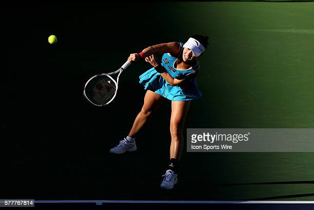 Jie Zheng of China serves to Maria Sharapova of Russia during the BNP Paribas Open at the Indian Wells Tennis Garden in Indian Wells CA