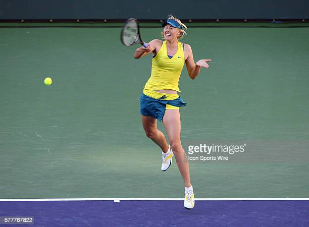Maria Sharapova of Russia in action against Jie Zheng of China during the BNP Paribas Open at the Indian Wells Tennis Garden in Indian Wells CA