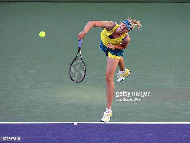 Maria Sharapova of Russia serves to Jie Zheng of China during the BNP Paribas Open at the Indian Wells Tennis Garden in Indian Wells CA