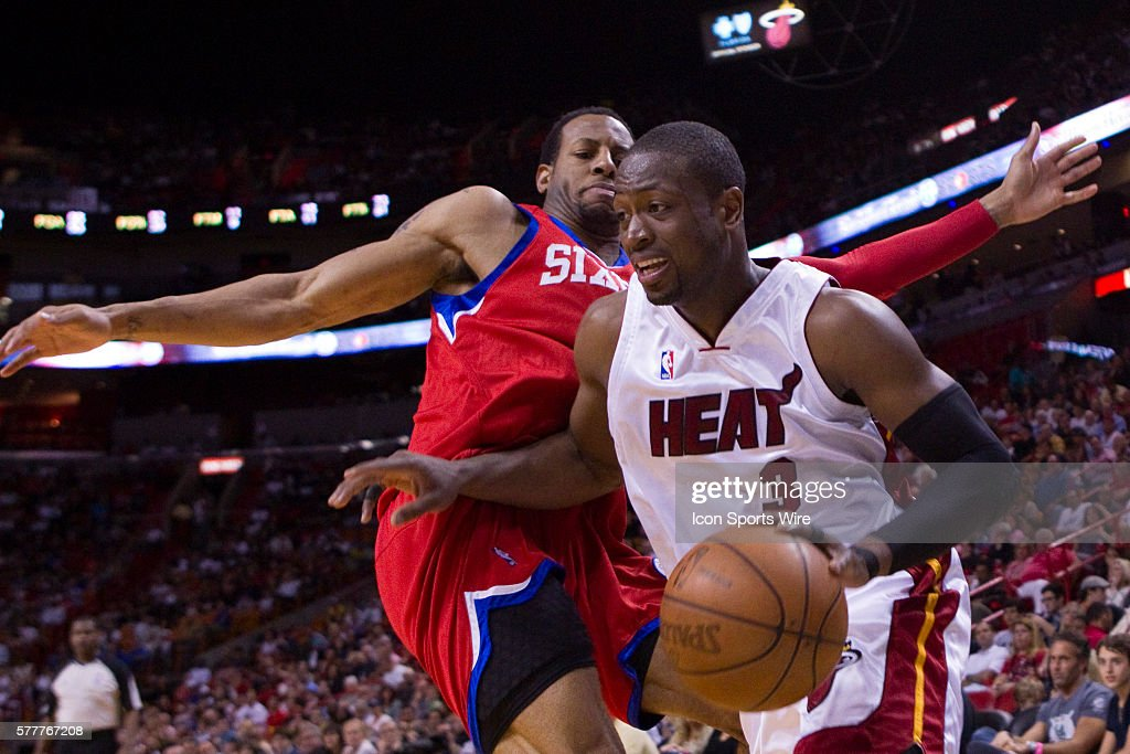 Miami Heat guard Dwyane Wade drives past Philadelphia 76ers guard Andre Iguodala during the Miami Heat 100-89 victory over the Philadelphia 76ers at the AmericanAirlines Arena, in Miami, Florida, USA.