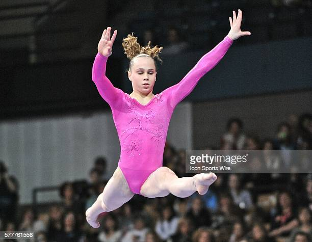 American Gymnast Rebecca Bross leaps high above the balance beam and does a split during the 2010 Tyson American Cup at the DCU Center in Worcester MA