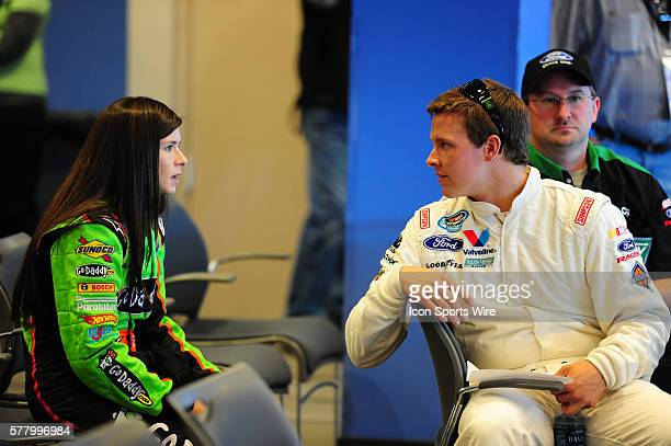 Danica Patrick Go Daddy Chevrolet Imapla SS and Trevor Bayne Roush Racing Ford Mustang have a conversation during the Sam's Town 300 driver's meeting...