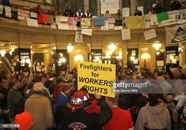 Protesters returned to the capitol building rotunda to gather following Wisconsin Governor Scott Walker's budget repair bill speech in Madison...