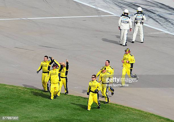 The crew of Mark Martin Dollar General Chevrolet Imapla SS celebrates the victory on pit row during the NASCAR Nationwide Series Sam's Town 300 at...
