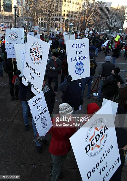 Protesters representing law enforcement march around the state capitol in protest of Wisconsin Governor Scott Walker's budget repair bill in Madison...