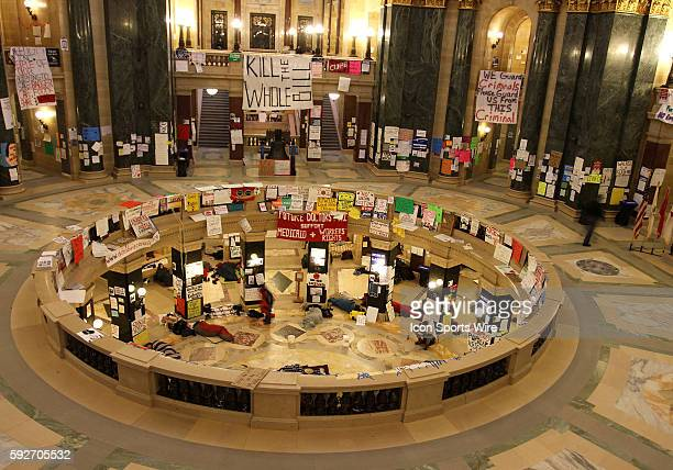 Protesters sleep in the state capitol rotunda floor on the 17th day protesting Wisconsin Governor Scott Walker's budget repair bill in Madison...