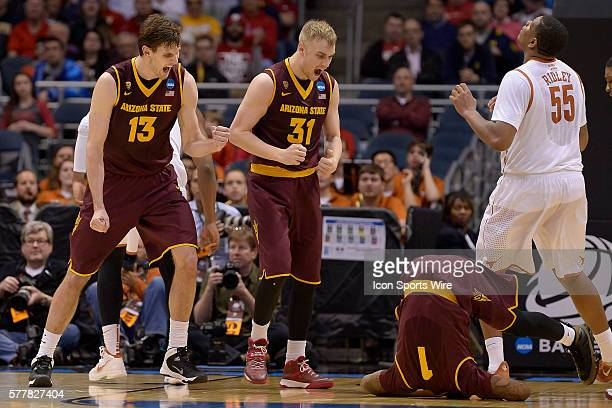Arizona State Sun Devils center Jordan Bachynski and Arizona State Sun Devils forward Jonathan Gilling try to help Arizona State Sun Devils guard...
