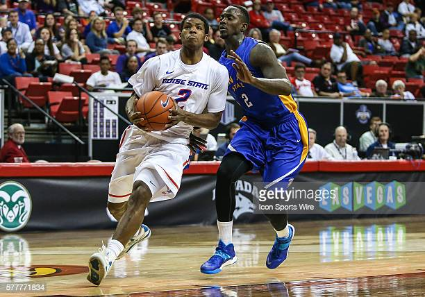 Boise State Broncos guard Derrick Marks drives past San Jose State Spartans forward Jaleel Williams to the basket during the game between San Jose...