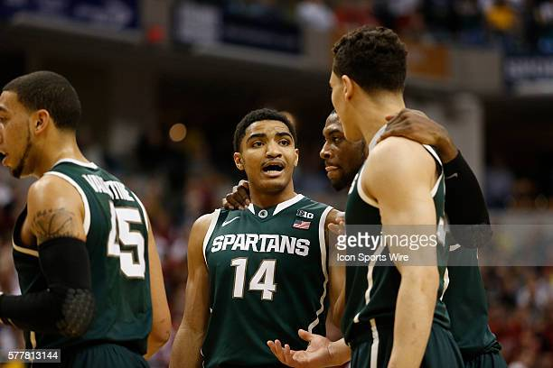 Indianapolis native Michigan State guard Gary Harris speaks with his teammates during the basketball game between the Wisconsin Badgers vs Michigan...