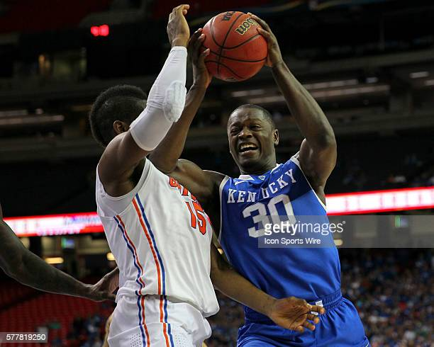Kentucky Wildcats forward Julius Randle dryves to the basket against Florida Gators forward Will Yeguete in the Florida Gators 6160 victory over the...