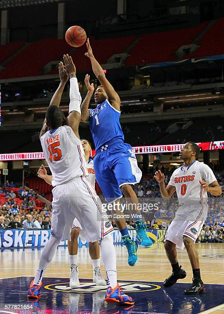 Kentucky Wildcats guard/forward James Young shoots over Florida Gators forward Will Yeguete in first half action of the Kentucky Wildcats v Florida...