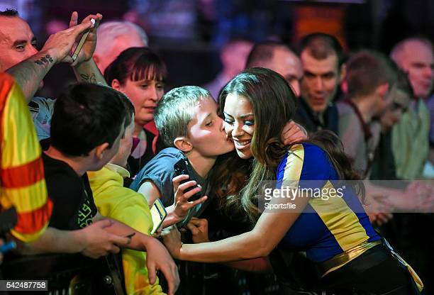27 March 2014 Matthew Pollard from Whiterock Hill Co Wexford gets a 'selfie' with walkon girl Hazel O'Sullivan during week eight of the Betway...
