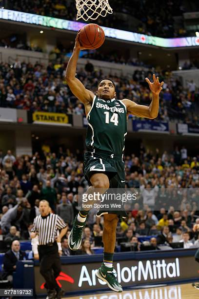 Michigan State guard Gary Harris goes in for the slam dunk during the Big Ten Championship basketball game between the Michigan Wolverines vs...