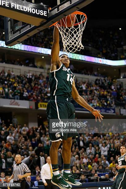 Michigan State guard Gary Harris slams down the dunk during the Big Ten Championship basketball game between the Michigan Wolverines vs Michigan...