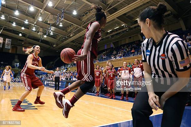 Oklahoma's Sharane Campbell keeps the ball from going out of bounds with a behind the back pass towards Nicole Kornet as referee Tiara Cruse ducks...