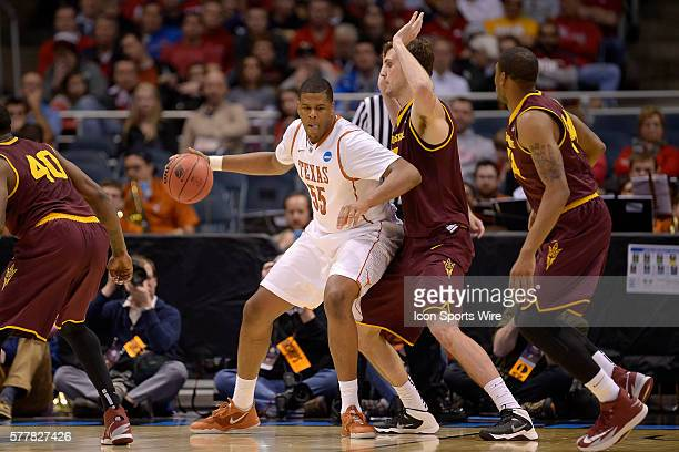 Texas Longhorns center Cameron Ridley battles with Arizona State Sun Devils center Jordan Bachynski in action during the Div I Men's Championship...
