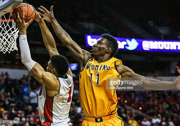 Wyoming Cowboys forward Derek Cooke Jr tries to block the shot of UNLV Rebels forward Roscoe Smith during the game between Wyoming Cowboys and UNLV...