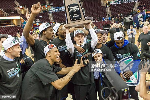 Buffalo Bulls head coach Bobby Hurley hoists the tournament trophy as he and the Buffalo Bills celebrate following the MAC Men's Basketball...