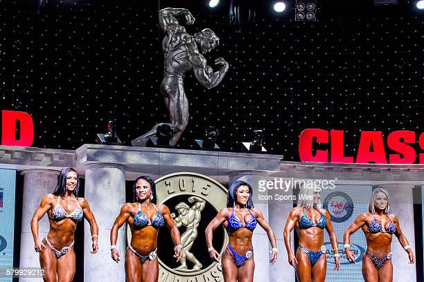 Competitors compete in Women's Figure as part of the Arnold Amateur Bodybuilding Fitness Figure Bikini and Physique Championships at the Arnold...