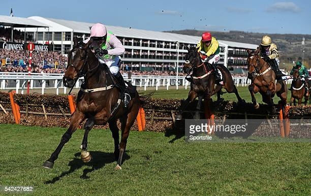 10 March 2015 Douvan with Ruby Walsh up jumps the last ahead of Sizing John second from right and Shaneshill on the way to winning the Supreme...