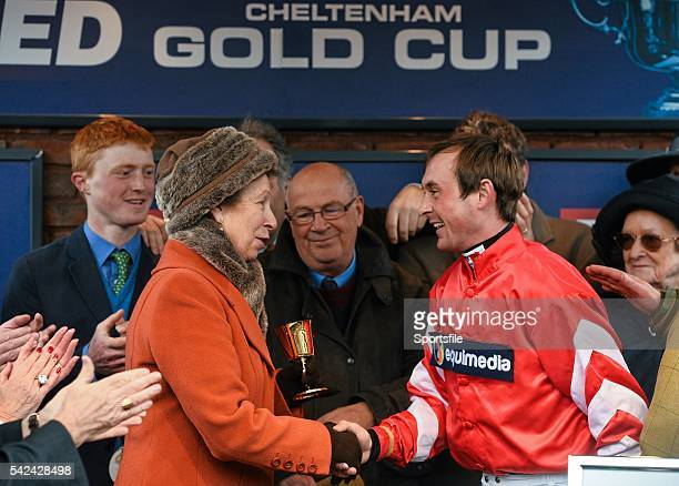 13 March 2015 Jockey Nico de Boinville is presented with The Gold Cup by Princess Anne after winning the Cheltenham Gold Cup on Coneygree Cheltenham...