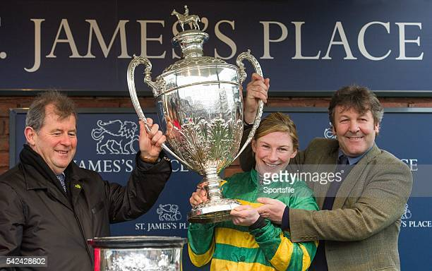 13 March 2015 Jockey Nina Carberry owner JP McManus and trainer Enda Bolger lift the Foxhunter Chase trophy after victory in the Foxhunter Chase with...