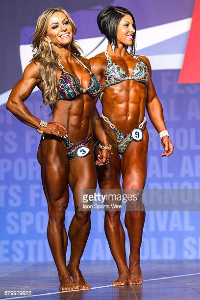 Juliana Malacarne and Dana Linn Bailey await the announcement of the winner of Women's Physique as part of the Arnold Sports Festival at the Greater...