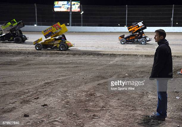 Kasey Kahne, NASCAR Sprint Cup Driver and World of Outlaws car owner, watches the race from the infield during the feature event of the World of...