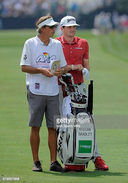 Keegan Bradley and his caddie on the 1st hole during the final round of the Arnold Palmer Invitational at Arnold Palmer's Bay Hill Club Lodge in...