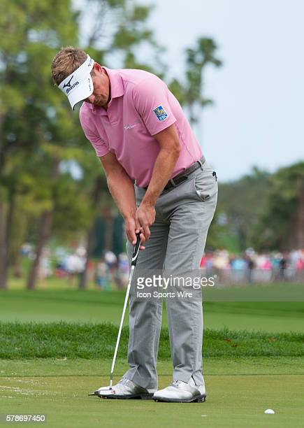 Luke Donald strokes in the 4th green in the Third round of The Honda Classic at PGA National Resort Spa Champion Course in Palm Beach Gardens FL
